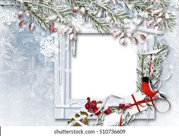 Christmas background with photo frame, bullfinch, snow branches and red berries