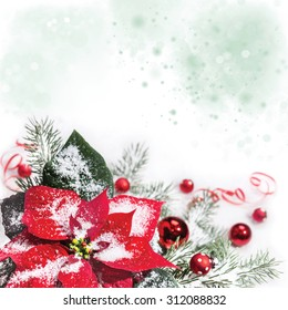 Christmas background with poinsettia, Christmas tree and baubles on snow, space for your text