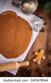Christmas background. Christmas preparation, kitchen table with dought for cooking gingerbread man