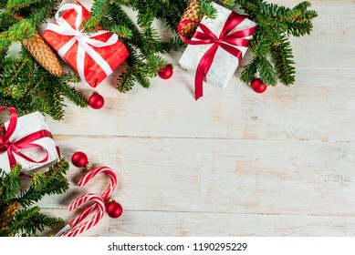 Christmas background with Christmas present gifts box and decoration, fir tree branchesabove copy space for text