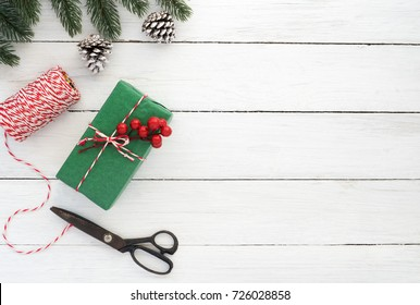 Christmas background. Christmas present wrapping over wooden table background.   Creative Flat layout and top view composition