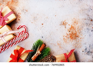 christmas background, presents and candycanes on a table