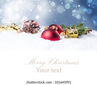 Christmas background with a red ornament on snow, Holiday decoration