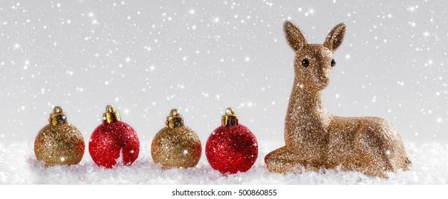 Christmas background with reindeer and Christmas balls. Panoramic image
