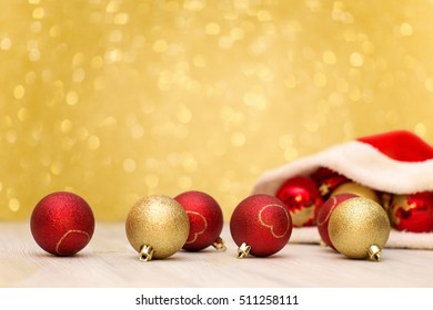 Christmas background. Santa Claus hat and red  and gold balls