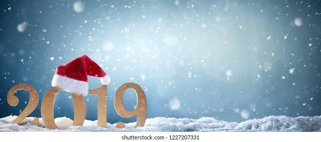Christmas background with Santa hat and 2019