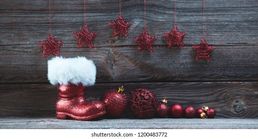 christmas background with santas boot and christmas baubles