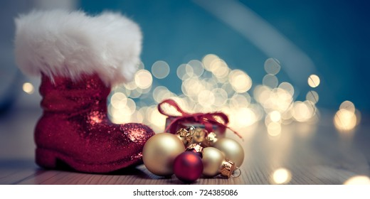christmas background with santas boot and gift