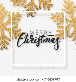 Christmas background with Shining gold Snowflakes. Lettering Merry Christmas