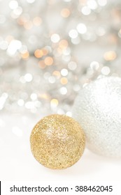 Christmas background with silver and gold Christmas balls and lights.