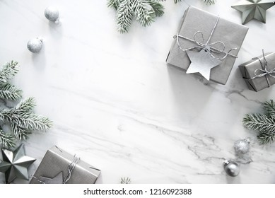 Christmas background with silver xmas gifts on marble background. Merry Сhristmas greeting card. Winter season holidays. Happy New Year.