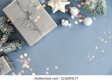 Christmas background with silver xmas gifts on blue. Merry Сhristmas greeting card. Winter season holiday background. Happy New Year.