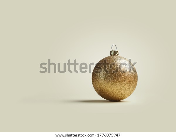 Christmas background with a single golden Christmas bauble on a bright background with space for text