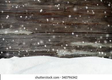 Christmas background with snow and blurred wood texture
