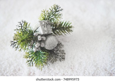 Christmas background with snow fir tree and new year decoration, baubles and gifts . Top view with copy space for your text