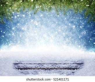 Christmas background, snow on wood under fir