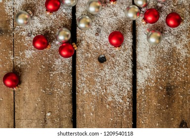 Christmas background with snow and small Christmas balls. with some copy space leftover