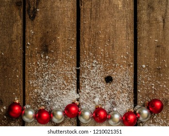 Christmas background with snow and small christmas balls. with some copy space left for text