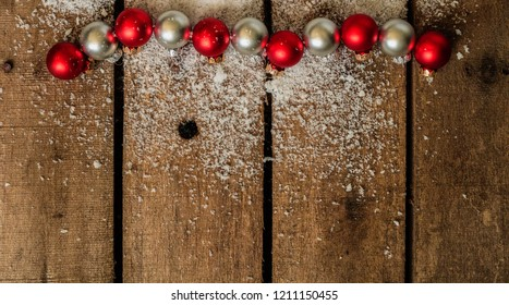 Christmas background with snow and small christmas balls. with copy space left for text