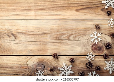 Christmas Background With Snowflakes And Cones On Wooden Table Copy Space Top View