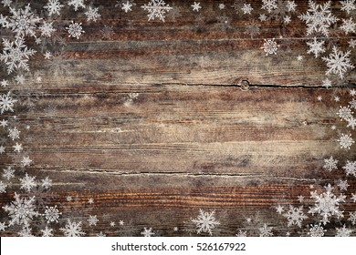 Christmas background with snowflakes on wooden texture