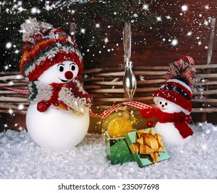 Christmas background with snowman and gifts