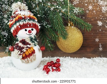 Christmas background with snowman and christmas tree