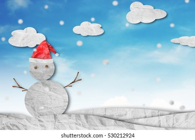 Christmas Background, Snowman wearing red Santa hat in winter with white clouds snow, paper cut made of crumpled paper