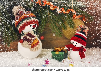 Christmas background with snowmen on a background of Christmas tree