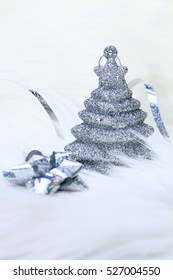 Christmas background with snowy silver tree
