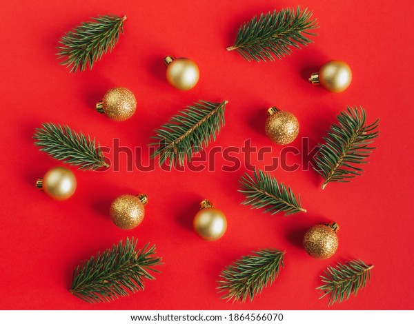 Christmas background with spruce branches and golden balls. Holiday minimal concept. Flat lay.