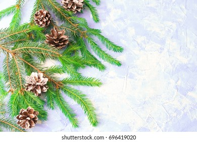 Christmas background with spruce, cones and toys