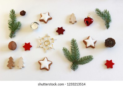 christmas background with stars, trees, pine branch, cookies and walnuts on white background