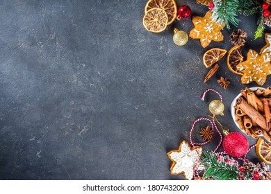 Christmas background. Table for cooking Christmas holiday baking cookies and cakes with ingredients above copy space