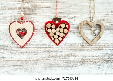 Christmas background. Three Christmas hearts on wooden background. Copy space