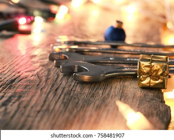 Christmas background with tools on a rustic wooden table