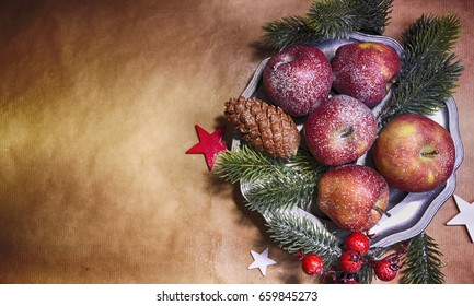 Christmas background, top view, apples on the lintage plate