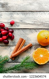 Christmas background. Top view. Fresh cranberry, cinnamon and clementines.  Rustic food photo. Vertical top view.