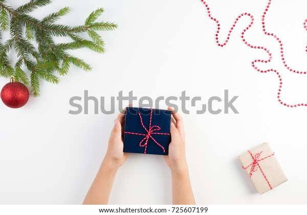 Christmas background. Top view of kid hands holding a present