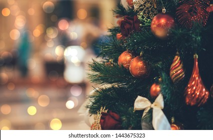 Christmas background. Christmas tree with beautiful bright festive decorations. Festive street decor in winter holidays.