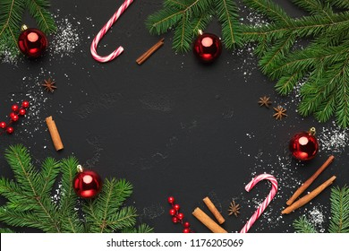 Christmas background with christmas tree branches and candy cane sweets