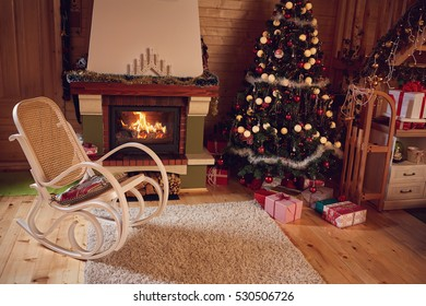 Christmas background with Christmas tree and fireplace in room with gifts