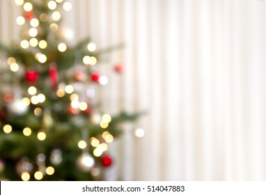 christmas background with christmas tree out of focus