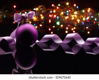 Christmas Background with Violet Ball and Ribbon