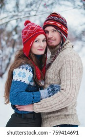 Christmas Background - Winter lifestyle consept - loving couple have fun in the park - Healthy lifestyle - Couple in Love