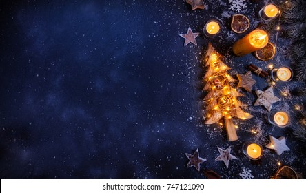 Christmas background with wooden decorations and candles. Free space for text. Celebration and decorative design.