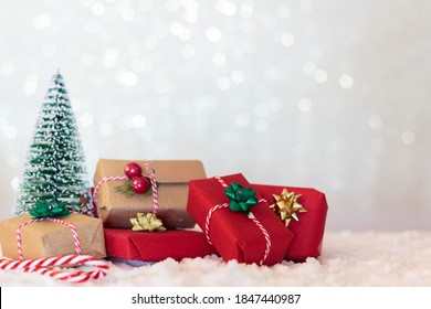 Christmas background with wrapped gifts and chistmas tree. With copy space