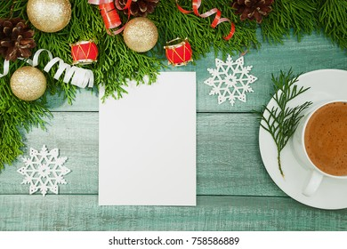 Christmas background or Xmas card. Holiday decorations and list for greeting on the green rustic table, flat lay style. Planning concept. Top View. Festive mood