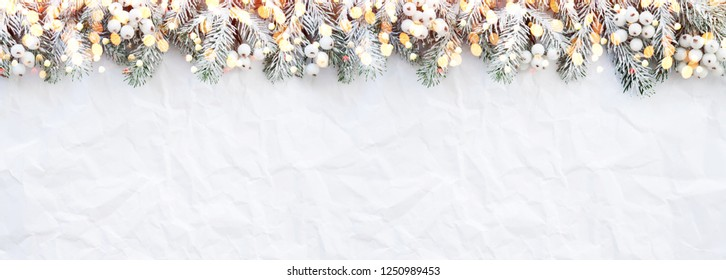 Christmas background with xmas fir tree on white creased background. Merry christmas greeting card, frame, banner. Winter holiday theme. Happy New Year. Space for text. Flat lay