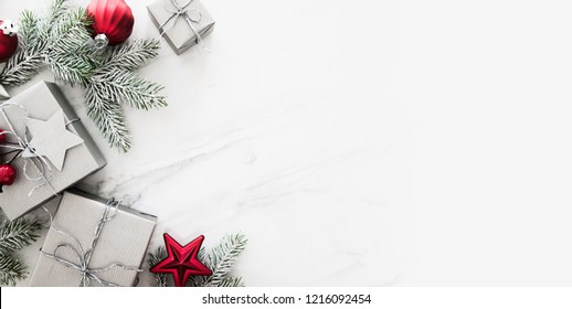Christmas background with xmas gifts on marble background. Merry Сhristmas greeting card. Winter season holidays. Happy New Year.